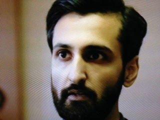 Journaliste Enquêteur Malik Suri (Arsher Ali)
